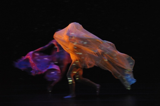 Dancers playing star encounters in the universe. (Copyright Stan Barouh http://stanbarouhphotography.smugmug.com/Theater/University-of-Maryland-School).