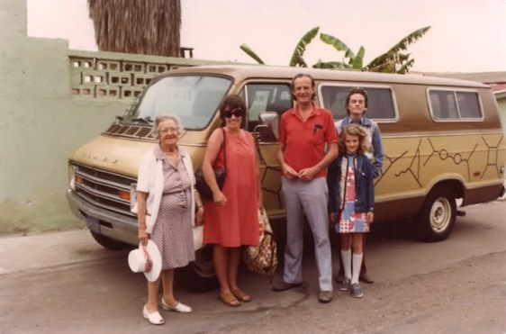 Professor Feynman poses with his family in front of his van, which he decorated with instances of his very own visual handle on particle physics.